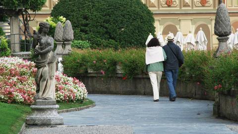 People walking through gardens near Lake Como in Italy Footage