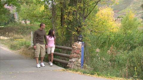 Couple stopping on a pathway on their walk Live Action