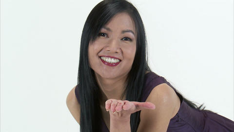 Woman blowing a kiss to the camera and smiling Live Action