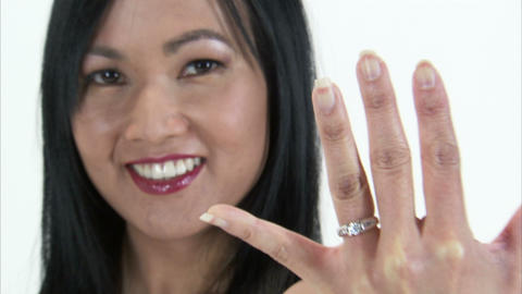 Close up rack focus from woman to her hand and engagement ring Live Action