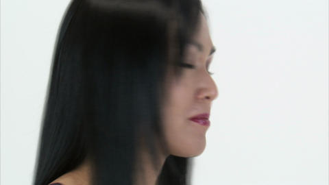 Close up of a woman turning to the camera and blowing a kiss, Live Action