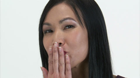 Close up of a woman turning to the camera and blowing a kiss Live Action