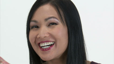 Close up of a woman turning to the camera and blowing a kiss Stock Video Footage