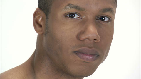 Close up shot of a man's face as he stares at the camera Footage