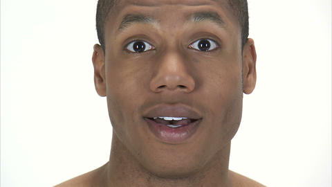 Man's face looking up with a surprised expression Footage