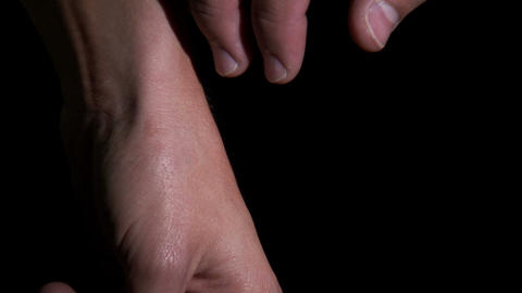 Close up of hands moving slowly to hold each other Live Action
