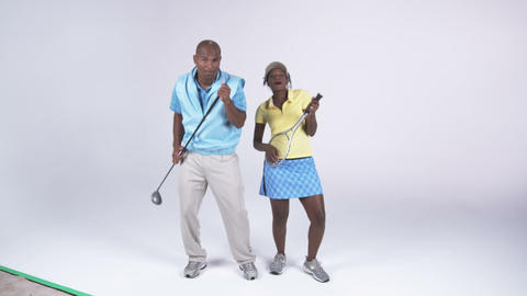 Young african american couple dressed in casual attire dances and sings Footage