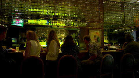 Panning shot of a busy bar Footage