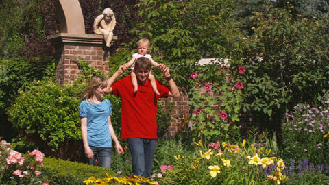 Young family walking through beautiful gardens Footage