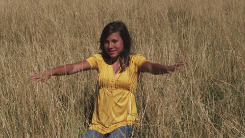 Smiling woman in a wheat field meditates Footage