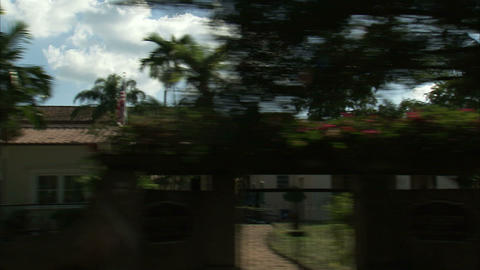 Residential area of Miami seen from a driving car Live Action