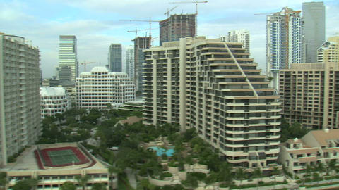 Flying around tall hotels and apartments in Miami Footage