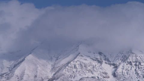Clouds obscuring mountain summits Footage