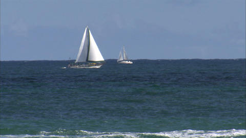 Motorboat passing in front of sailboats Footage