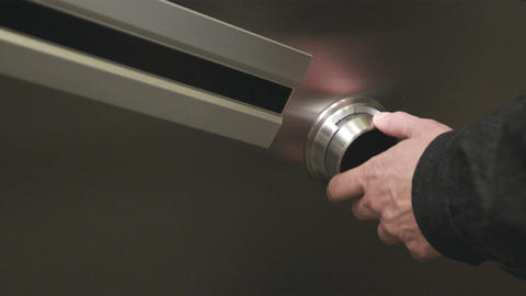 Shot of a hand turning a safe-dial Footage