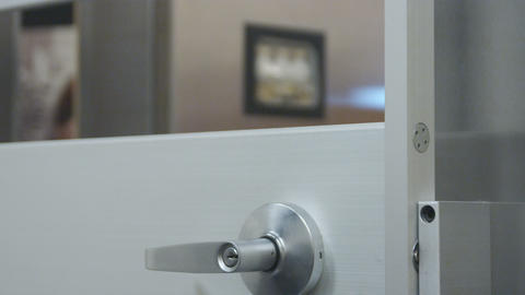 Close-up shot of door shutting with safe in background Live Action