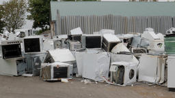 Old, used washing machines, cookers and fridges. Recycling center ビデオ