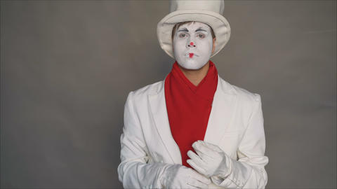 Dangerous mime. Portrait of a joker. Crazy image of a man in a white suit. Mime Footage
