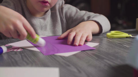Girl's hands glueing a card. Valentine's Day Stock Video Footage