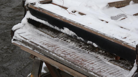 Old snowy piano musical instrument near winter river Live Action