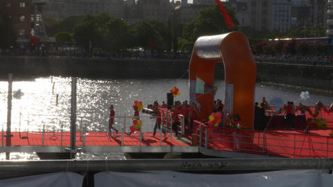 Chinese row crew arriving at pier stage in the Chinese new year celebration race Footage