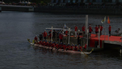 Dragon boat departure of the pier to compete in the Chinese new year celebration GIF
