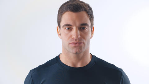 Portrait of athletic guy in a black t-shirt on white background Live Action