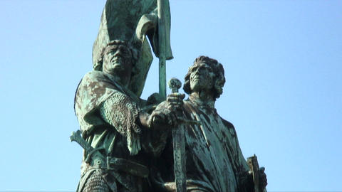 Statue of two men with a sword Live Action