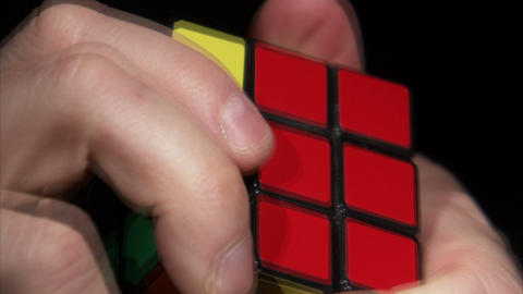 Close up of a Rubik's Cube being solved Footage