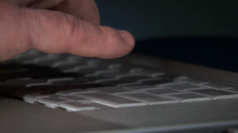 Close up shot of a man typing on a laptop keyboard Footage