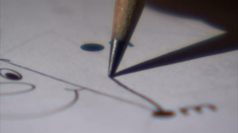 Extreme close up of a pencil connecting dots Live Action