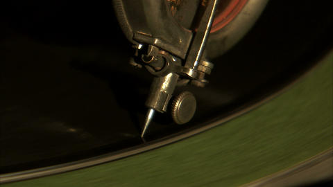 Extreme close up of a record needle dropping to the record Live Action