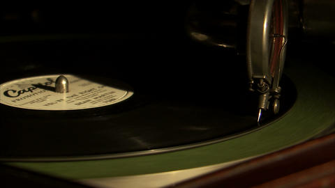 Close up of a record needle dropping onto a record Live Action