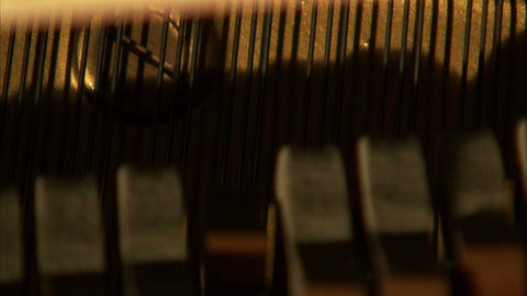 Close up of piano hammers striking the strings Footage