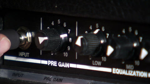 Rack focus from guitar amp knobs to cord Footage