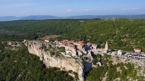Aerial - Seaside village on the edge of a cliff. Destination scenic, Lubenice Footage