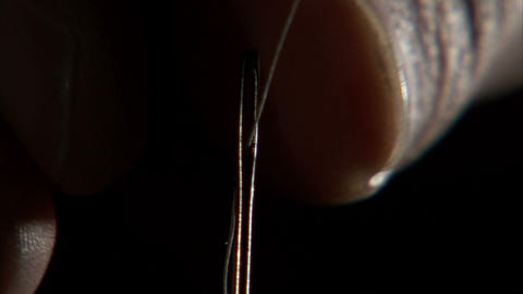 Extreme close up of a needle being threaded Live Action