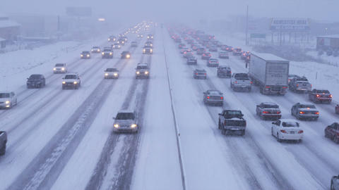 Clip of traffic in winter storm Footage