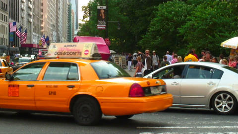 Cars taxis and a horse and carriage in New York City Footage