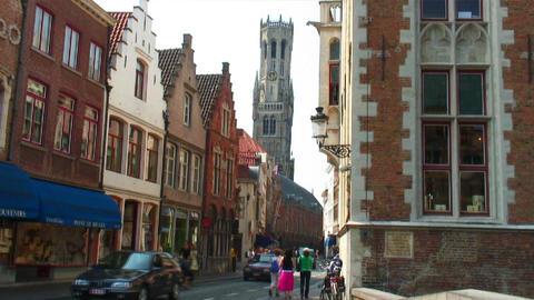 Belfry of Bruges seen above buildings in Belgium Live Action