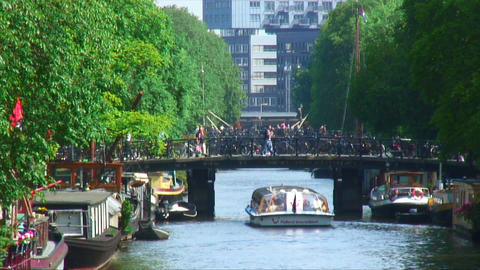Cruise ferry passing under a canal bridge in Amsterdam Footage