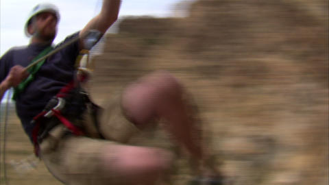Mountain climber jumping over the camera Live Action