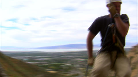 Shot of a rock climber jumping over the camera Footage