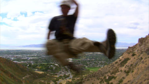 Clip of a rock climber jumping over the camera Live Action