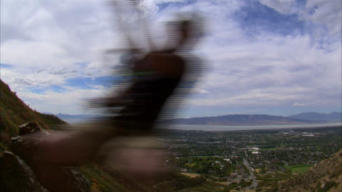 Shot of a mountain climber hopping over the camera Footage