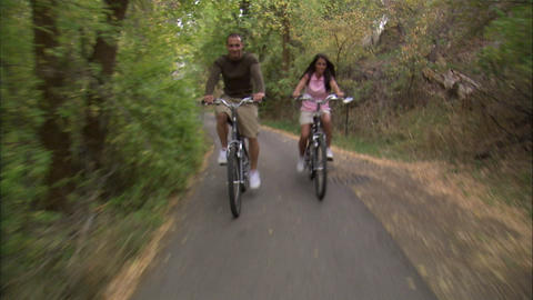 Man and woman riding bikes Footage