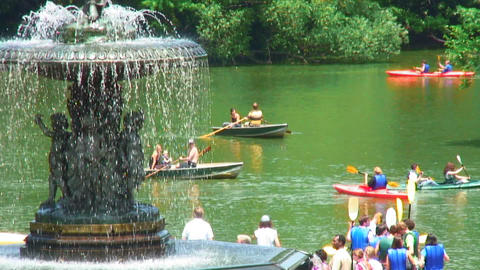 People in boats near Bethesda Terrace in Central Park NYC Footage