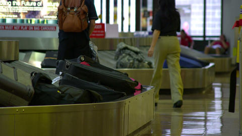 Bags travel around baggage claim carousels at the airport Footage