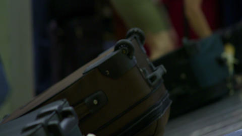 Racking focus shot of luggage on a baggage carousel Footage