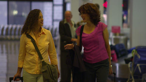 SALT LAKE CITY, UTAH - CIRCA 2012: Two women walk through the airport in Salt La Footage